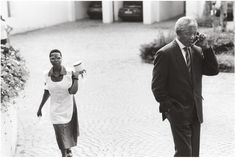 Mandela on cell phone with then President FW de Klerk discussing the violence in the country just before the elections, Johannesburg, Photo © George Hallett