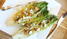 Grilled Romaine Hearts   I make Grilled Caesar Salads using romaine hearts, Caesar dressing, parmesan cheese, and croutons.  Can add grilled chicken too.