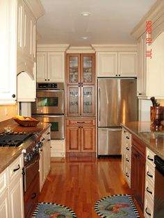 Two tone traditional kitchen. The darker wood works just perfect as an accent to stand out different task areas. http://www.iycdesigns.com/#!untitled/zoom/c19a6/imagemkx
