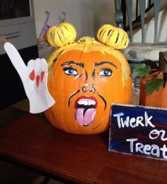 Miley Cyrus Halloween Pumpkin  ---- funny pictures hilarious jokes meme humor walmart fails