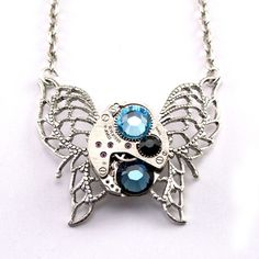 Steampunk Necklace - A Vintage Watch Movement Butterfly Accented with Light Sapphire Montana Blue and Jet Swarovski Crystals By London Particulars $49.00