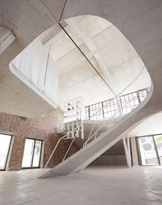 The Typical Loft Reinterpreted With A Sculptural Staircase