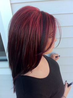 Pretty bright red hair highlights . Used Paul Mitchell hair color