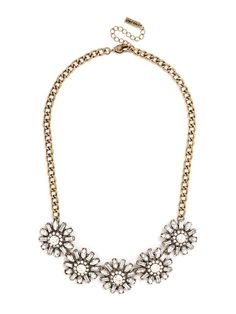 This luxe statement necklace features graphic blossoms with baguette and marquise petals for a vintage-inspired look with modern sparkle.