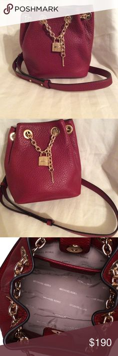 Michael Kors Hadley Messenger Messenger bag from Michael Kors. Cherry pebbled leather with gold hardware. Excellent like new condition. MICHAEL Michael Kors Bags Crossbody Bags
