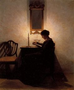 """Woman Reading by Candlelight"" in 1908, oil on canvas by Peter Ilsted (1861-1933)."