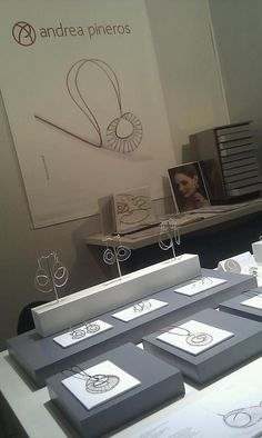 minimal pieces, nice impact.  two tone display and and dowels for earring display.  awesome display and jewelry