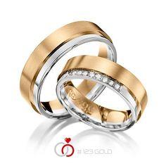 1 Paar Trauringe - Legierung: Graugold 585/- Roségold 585/- Breite: 6,00 - Höhe: 1,60 - Steinbesatz: 9 Brillanten zus. 0,09 ct. tw, si (Ring 1 mit Steinbesatz, Ring 2 ohne Steinbesatz)