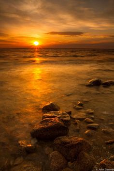 Sunrise over Lake Michigan by Pure Michigan.