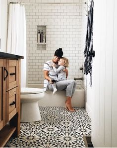 from ameliahannah instagram. like the cement tile floor, the stain of the wood vanity, dark grout in shower and vertical panelling on walls