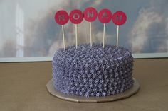 purple piped star cake with paper flags