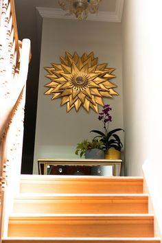 Here's a gold sunburst mirror made from manila folders via Brooklyn DIY Designs.