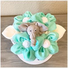 Items similar to Grey and Teal Elephant Baby Shower Centerpiece - Gender Neutral New Baby Gift Bouquet Diaper Cake on Etsy Small Diaper Cakes, Elephant Baby Shower Centerpieces, Diaper Cake Centerpieces, Towel Animals, Gift Bouquet, New Baby Gifts, Gift Packaging, New Baby Products, Wedding Gifts