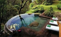 Amazing landscape design with an infinity pool.