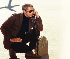 True Calling- Steve McQueen in his trade mark natty tweed and turtleneck combo on a seriously old school mobile phone