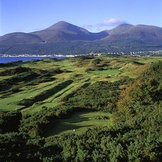 Royal County Down -- Newcastle, Northern Ireland  There's movement afoot to bring another Open Championship to Northern Ireland. I wish they'd bring one here, the most beguiling combination of beauty and brawn in golf. Your stride quickens as you race up the hills in hopes of locating your blindly-hit shots -- the better also to see the fearsome bewhiskered bunkers, massive gorse bushes and the Mountains of Mourne rising up beyond the shores of Dundrum Bay.