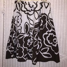 Flower Skirt Brown & White Drawstring waist band that ties in a bow gives comfort to this free moving skirt. Pair it with a tank top or a blouse. Heels or sandals. Work or play! Worn once. No stains. No rips. Please ask All ? Prior to buying!  @ photos . Bundle I am here for my Buyers ❤️ Skirts Circle & Skater