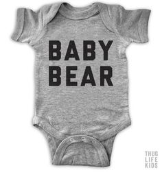 Baby bear!   White Onesies are 100% cotton. Heather Grey Onesies are 90% cotton, 10% polyester.  All shirts are printed in the USA.