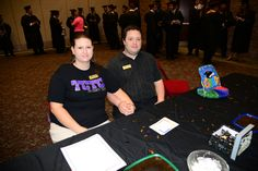 Ed and Hali Sullivan greeted grads at the Alumni Association table and provided graduates with hair pins, safety pins, a cheer, and a pat on the back.