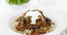 Our take on the family classic, chilli con carne. Tinned Tomatoes, Natural Yogurt, Vegetable Puree, Peppers And Onions, Slow Cooker, Stuffed Peppers, Meals, Cooking, Recipes
