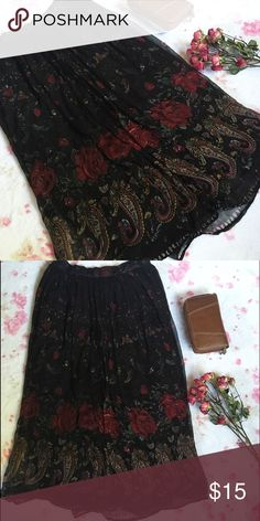 Long Flowy Gauze Skirt  A gorgeous long skirt with red roses and colorful swirls   By the brand Bila of California   Lightweight and has an elastic waist   Size medium but would fit also fit a large due to the elastic waist   Keywords: Boho , bohemian , 90s style , vintage style , gothic , soft punk , soft goth , hippie , soft grunge Bila Skirts A-Line or Full