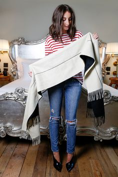 1. Start with either two oblong scarves with one end placed slightly longer than the other, or one Donni Mingle scarf.   - HarpersBAZAAR.com