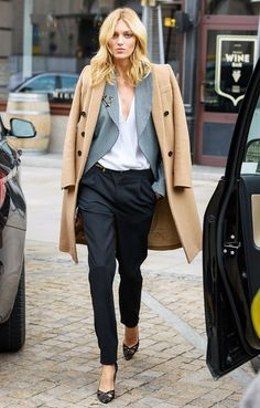 Anja Rubik in Camel Coat, Striped Blazer & Tailored Trousers.
