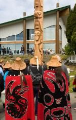 Hereditary Chiefs stand before new totem pole