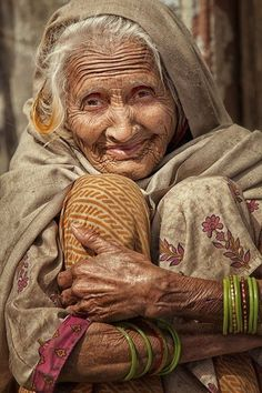 I love the wrinkles on her forehead, the glint of her eyes & the warm smile on her lips.  I