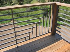 Intersecting Horizontal and Vertical Metal Slat Railing