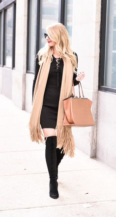 Little black dress with camel colored tote and shawl.