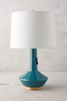 Simple Angelica Lamp Ensemble from Anthropologie will dress up any side table or night stand.