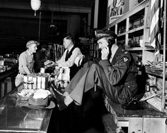While his father chats with a customer at the hardware store, a uniformed Jimmy Stewart sets up a date to go fishing, 1945.    Read more: http://life.time.com/history/col-jimmy-stewart-home-from-wwii/#ixzz1opmNMlsF
