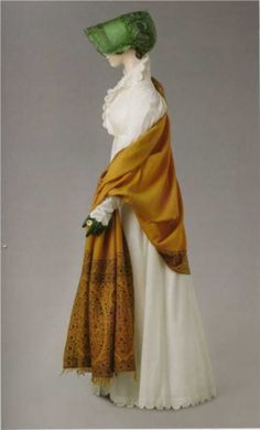 White percale redingote 1808-12. Shawl 1810. Green silk taffeta bonnet 1808-10. Napoleon and the empire of fashion