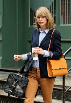 Taylor Swift toted her kitty around town. See more celebs with pets on Wonderwall: http://on-msn.com/1iI4HbL