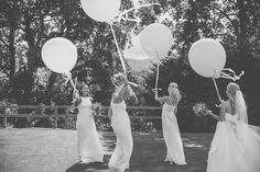 Image by O&C Photography - A welsh wedding at Peterstone Court in the Brecon Beacons with Essense of Australia gown a white colour scheme including zara bridesmaid dresses and huge balloons