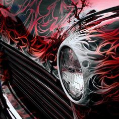 .It would be nice to see the entire car!! lol Still...cool flames and color.