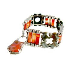 A beautiful handmade Victorian Scottish Agate and silver bracelet with hinged padlock fastening with photo/lock of hair compartment. , $431.78