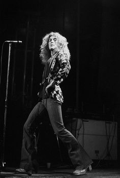 Robert Plant 1975, doing a bit of a lunge in heeled boots.  No wonder...