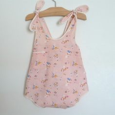 """sunsuit c. 1930  pink cotton sunsuit in  playful fairy tale fabric.  1 button at back neck +  elastic waist in back finished with sash ties.  or can be tied as shown in last photo.  loose fitting.    W: 11"""" (unstretched)  L: 18.5""""  Item Number:  R - 55 - op    Size:  3 - 4 years  more info    Color:  pink    Fabric:  cotton    Condition:  NP  more info    $55.00"""