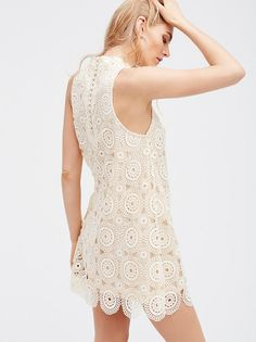 Selma Dress | Sweet crochet shift dress with a sophisticated high neckline and exposed back button closures. Pretty adjustable side tie detail. Soft and comfortable lining.