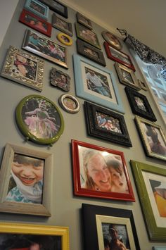Photo wall..LOVE this idea.  I have a hallway where we filled it up with random pics and mis matched frames.