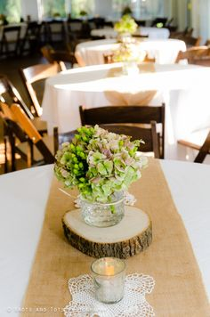Table set up- burlap runners and tree slabs via Save on Crafts