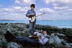 Beatles George Harrison and John Lennon in the Bahamas during the filming of their movie 'Help'. Photo by Henry Grossman 1965