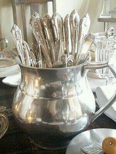 A Table Chez Jacqueline Sterling flatware is stored in the cabinet in this pewter jug and makes setting the table easy and fast. Left until last, it can give an early guest something to do . Cabin & Cottage: A Table Chez Jacqueline Silver Spoons, Silver Plate, Silver Trays, Vintage Silver, Antique Silver, Tarnished Silver, Zinn, Shabby Chic Kitchen, Dinnerware