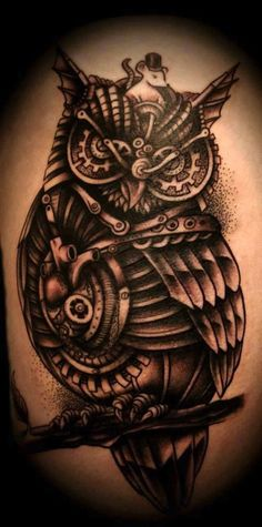 Cool bio-mechanical owl tattoo with a little mouse #TattooModels #tattoo