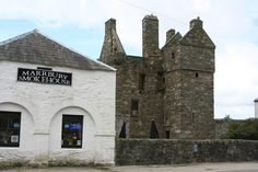 Background is Carsluith Castle (also known as Brown's castle), on Wigtown Bay, in Scotland