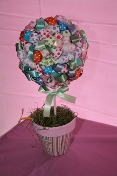 ribbon topiary - flower pot with scrapbooking paper modge podged and a painted pink rim