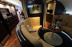 Welcome aboard: The luxury First Class section of the new planes will have their 'lobby' where millionaire passengers can sit and enjoy refreshments in more comfort