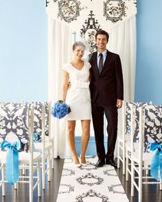 """A trio of coordinating patterns creates a personalized spot to say """"Ido."""" To make the valance, affix wallpaper to foam board with spray adhesive. The aisle runner? Double-stick-tape a roll to the floor. And for each chair cover, drape a strip over the back, punch two holes in each end, and tie on a ribbon."""